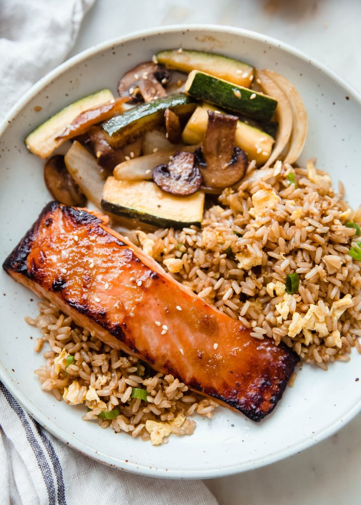broiled salmon over hibachi fried rice with zucchini, mushrooms, onion saute