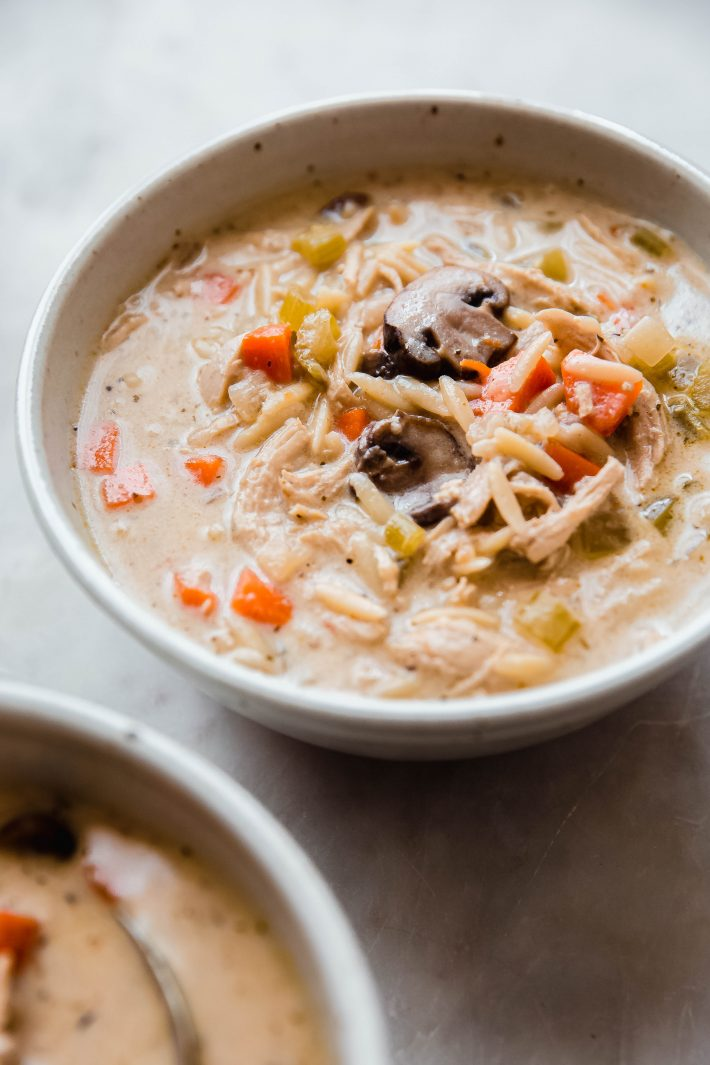 creamy chicken mushroom soup in a beige speckled bowl