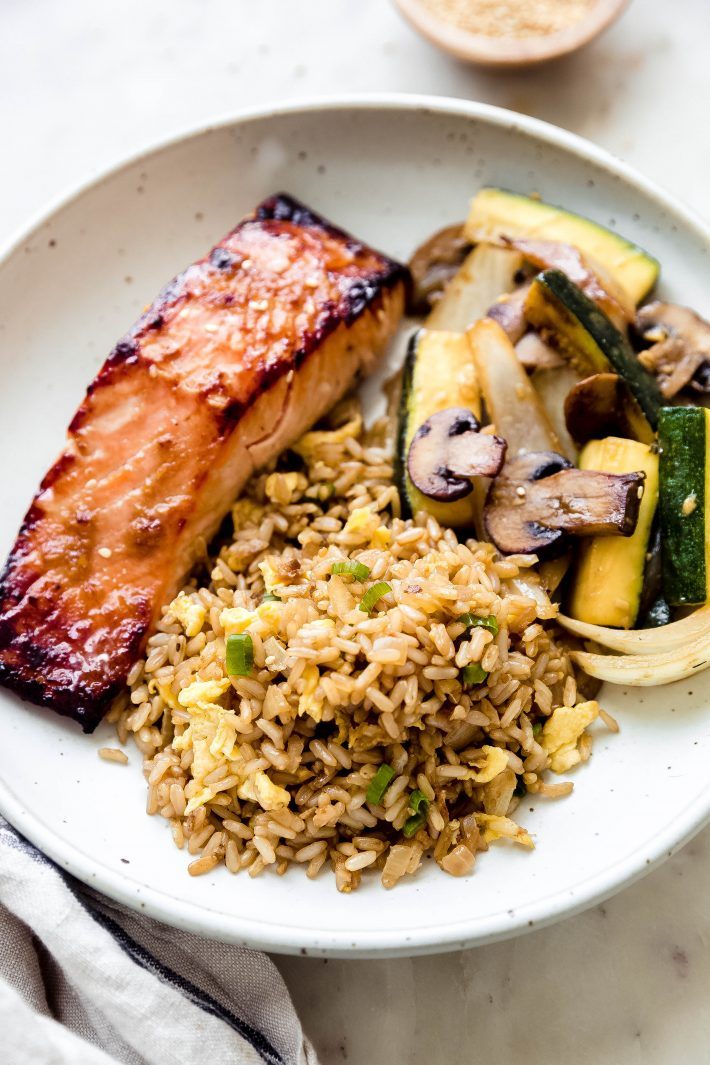 deep bowl with ginger miso salmon, sautéed veggies, and fried rice