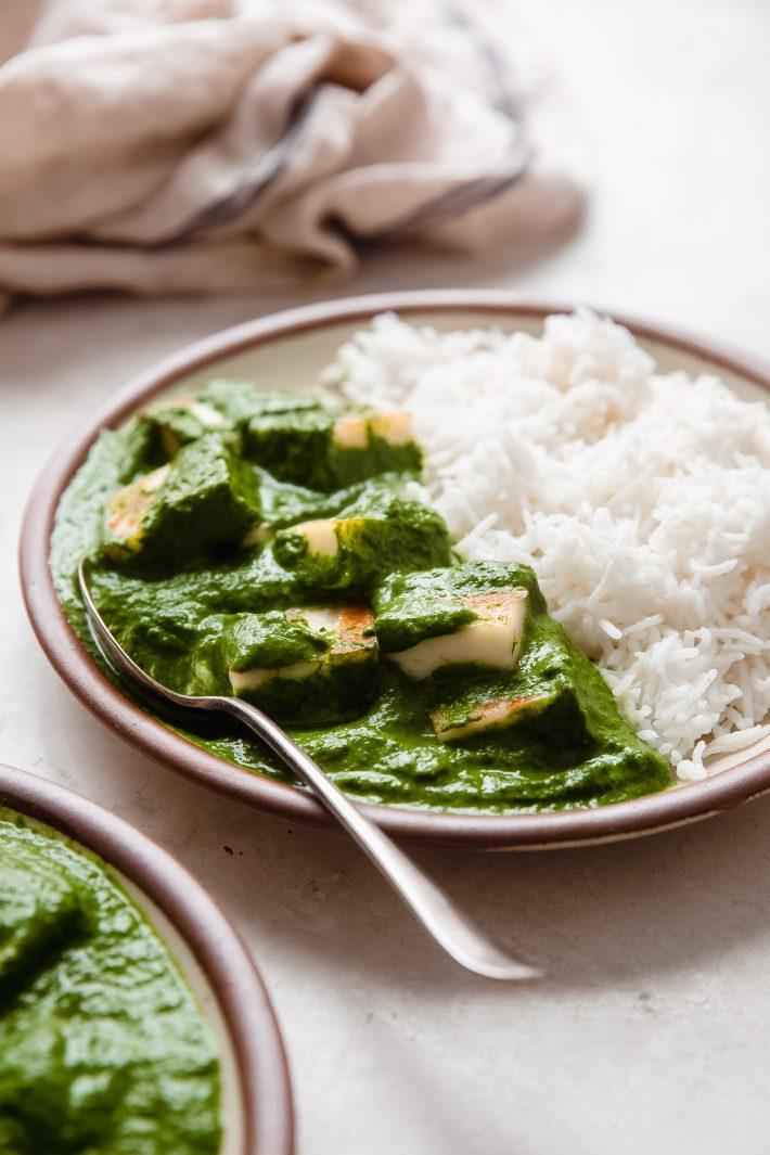 plate with prepared palak paneer and basmati rice