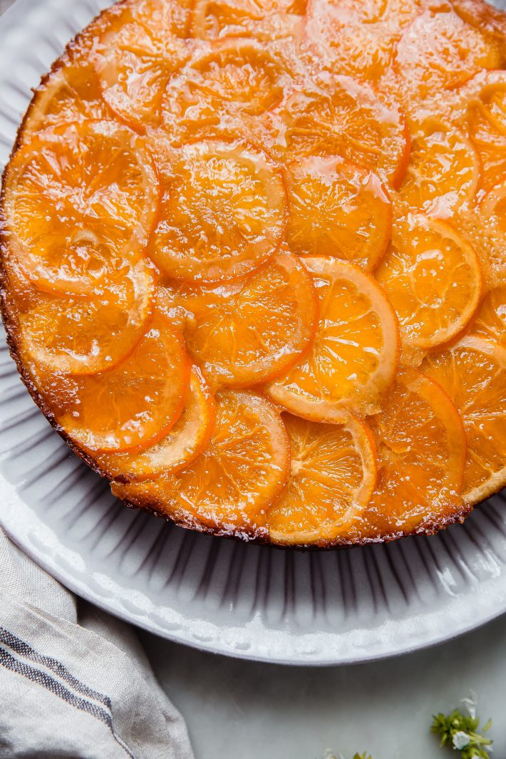 sliced candied oranges showing cake before slicing
