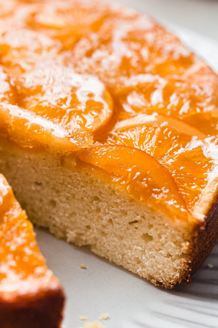 sliced cake showing inside texture and sliced candied oranges
