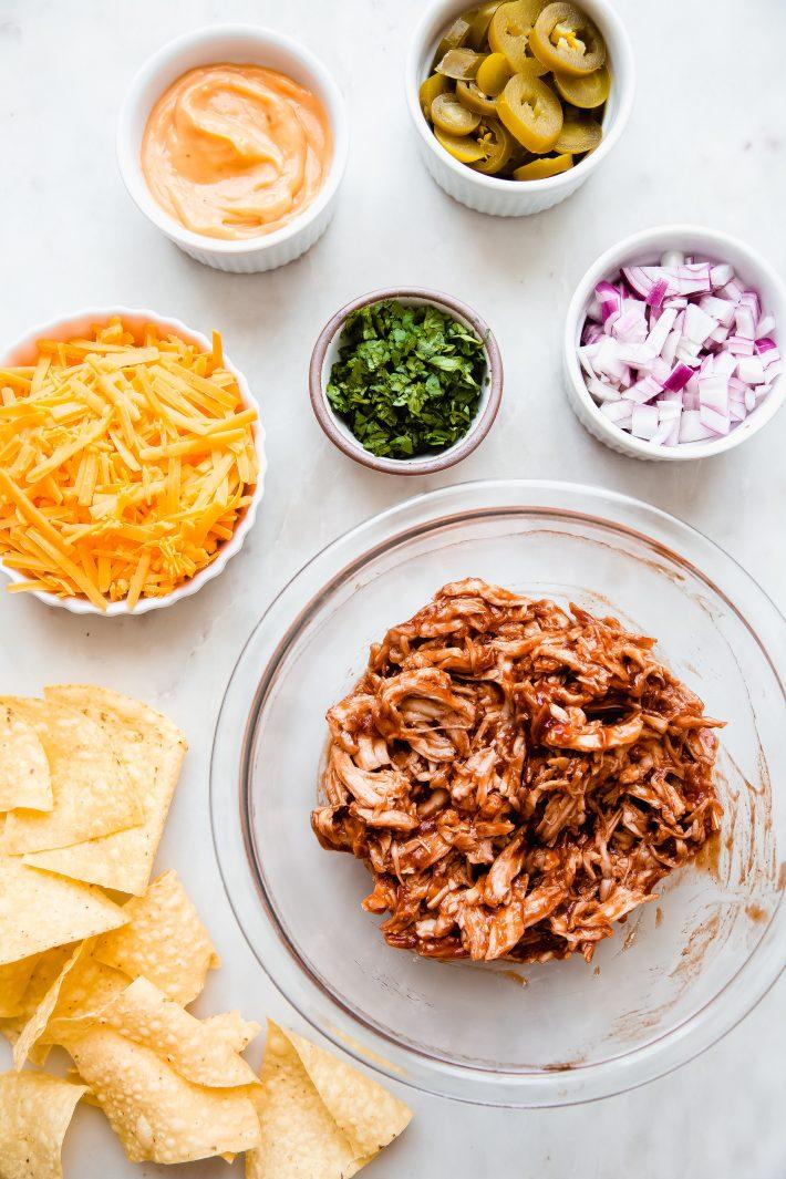 ingredients in bowls of bbq chicken nachos