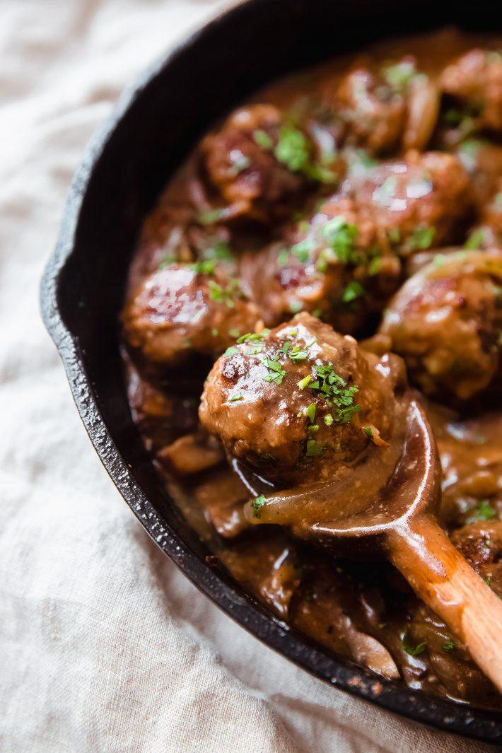 close up of meatballs in mushroom gravy