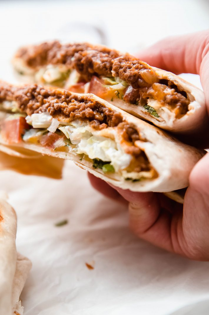 showing the inside layers of a Crunchwrap
