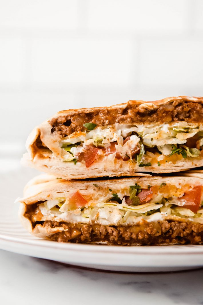 cut Crunchwrap with exposed centers on plate