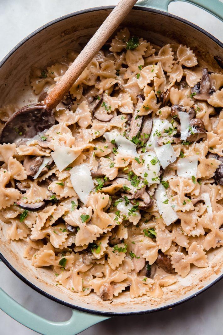 close up of one pot creamy mushroom pasta in cast iron pan