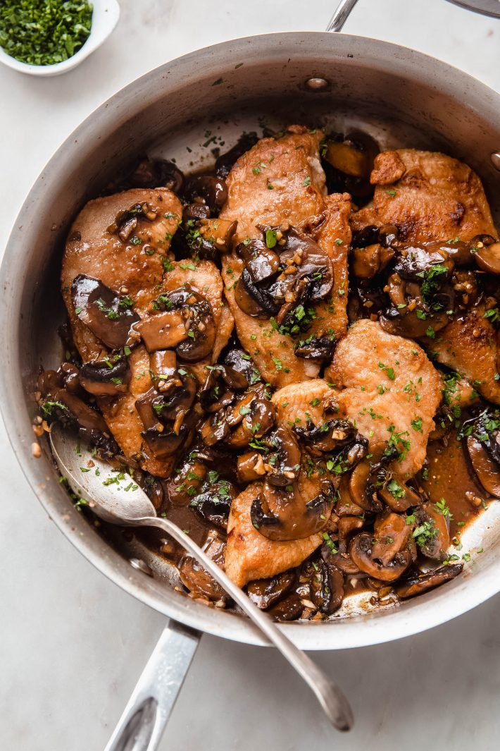balsamic mushroom chicken in saute pan topped with parsley