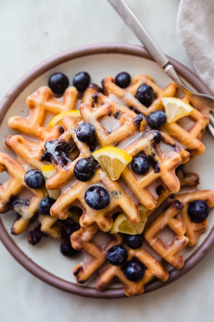 plate with stacked lemon blueberry waffles