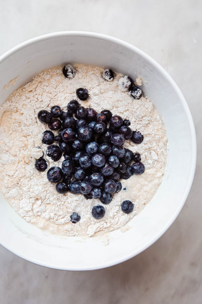 batter for waffles with fresh blueberries