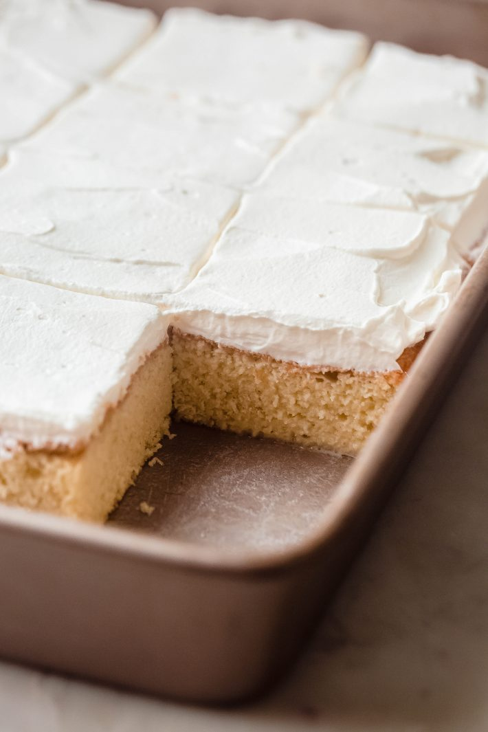 tres leches in baking pan with slice missing