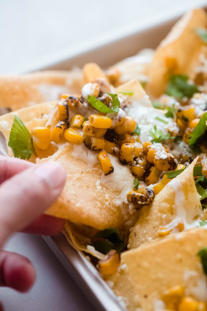 fire-roasted corn on tortilla chips with Oaxaca cheese, Cotija, fresh cilantro