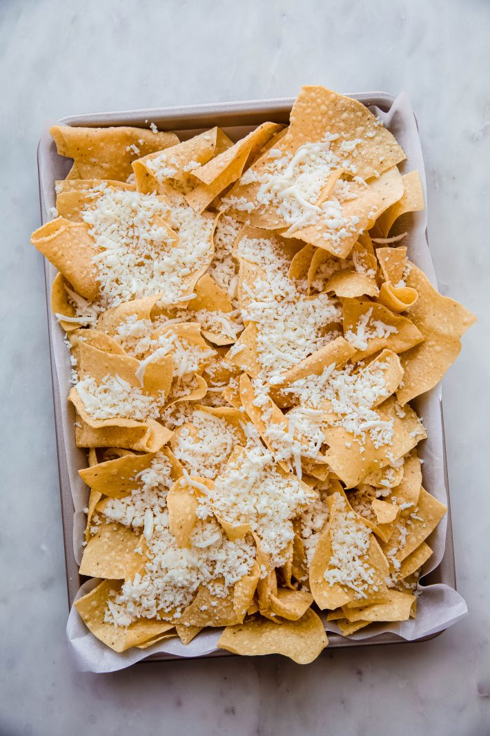 tortilla chips topped with shredded Oaxaca cheese