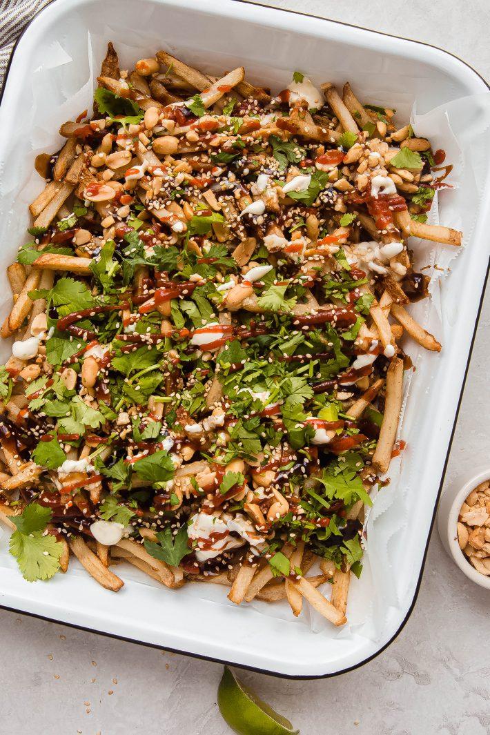 vietnamese loaded fries on enameled baking dish