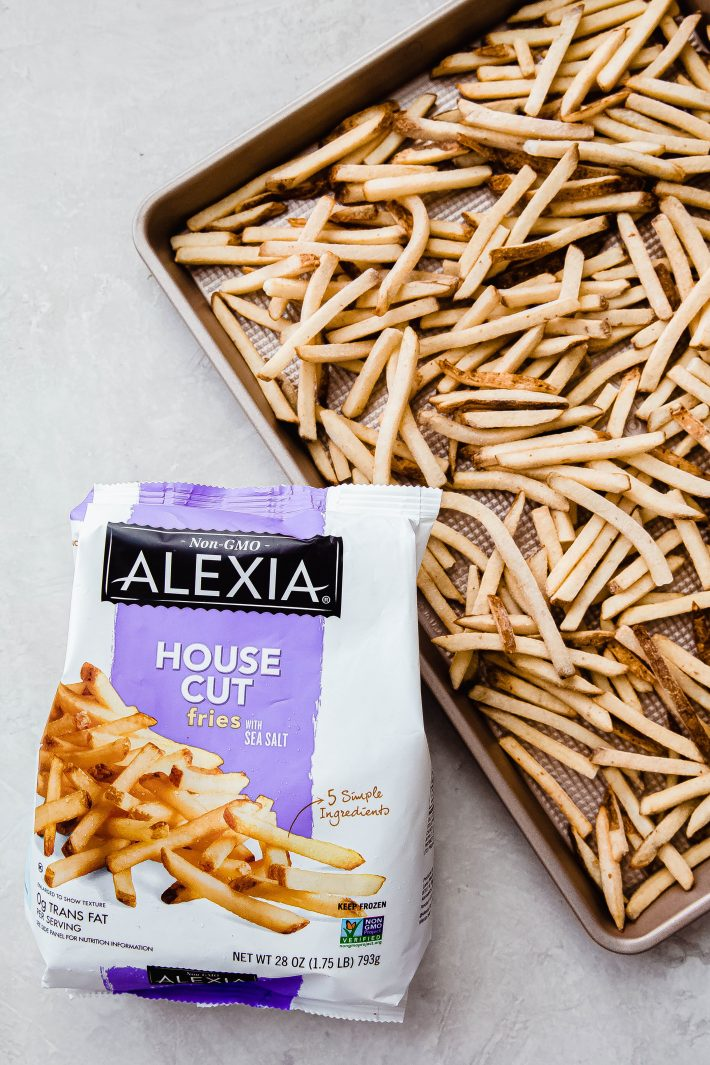 bag of French fries and fries on rimmed baking sheet