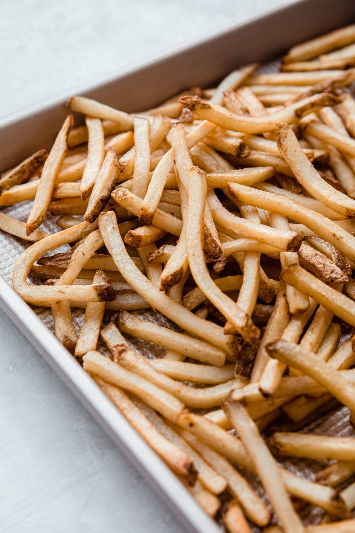 French fries on baking sheet