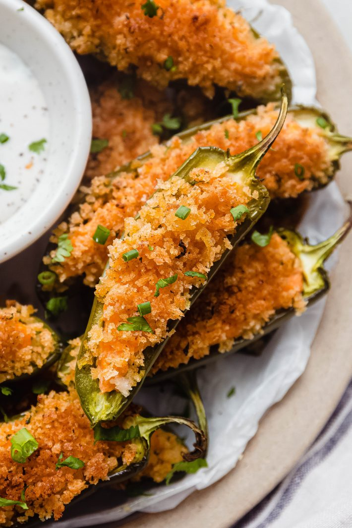 close up of jalapeno popper with scallions on top