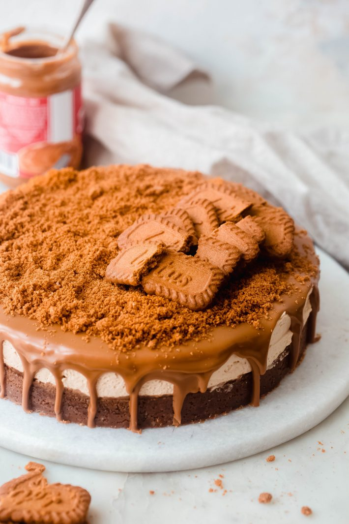 whole Biscoff Cheesecake on marble board