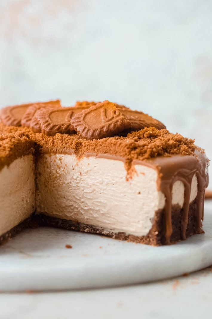 slice of cheesecake missing on white marble board