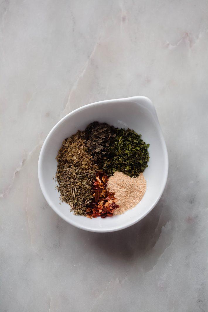 seasonings in Italian dressing in white pinch dish