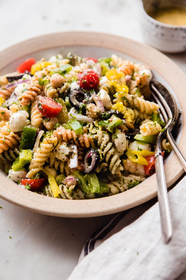 showing veggies and parmesan on italian pasta salad