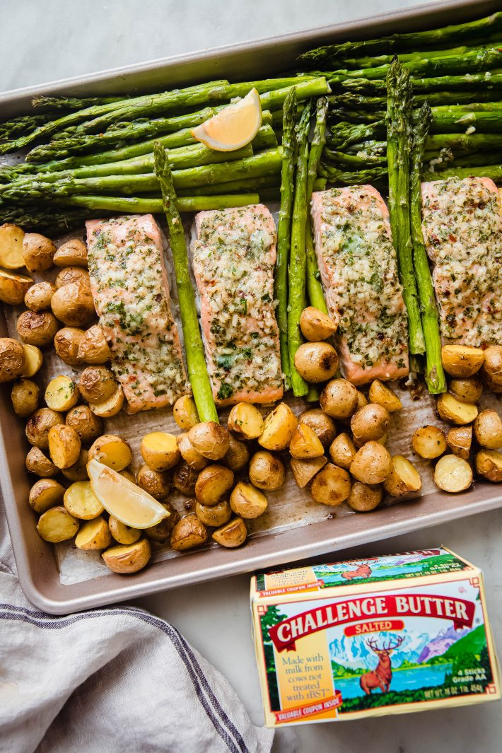 baked butter salmon, asparagus, and baby potatoes on white marble with butter package