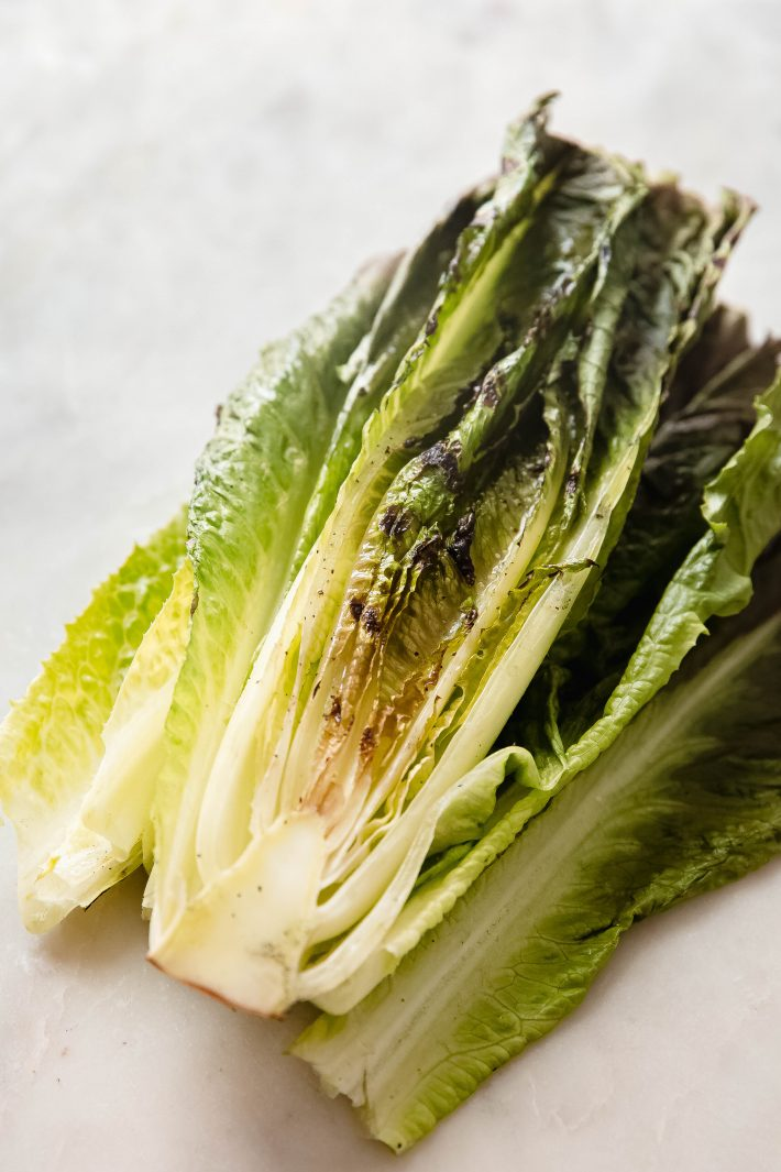 grilled romaine on white marble