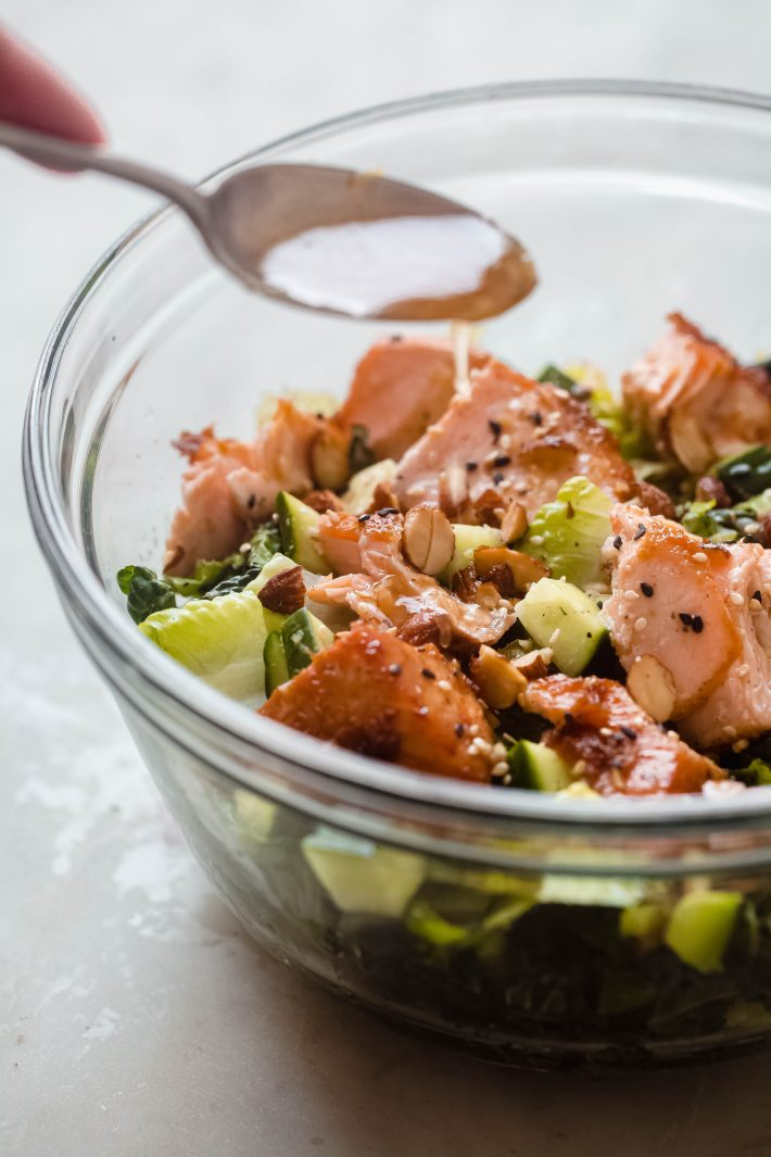 drizzling ginger salmon salad with dressing