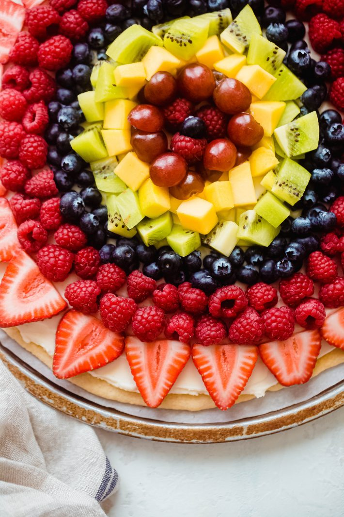 fruit pizza topped with colorful fruit
