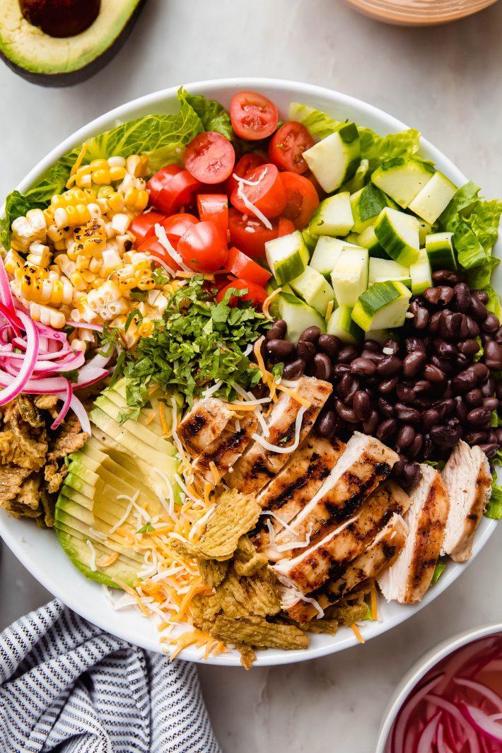 salad ingredients in bowl before dressing