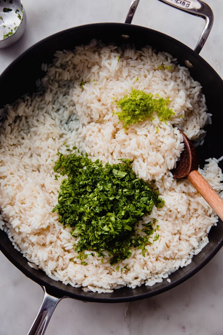 fluffy rice with cilantro and lime zest before mixing