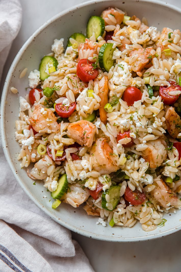 tossed orzo shrimp salad in speckled plate