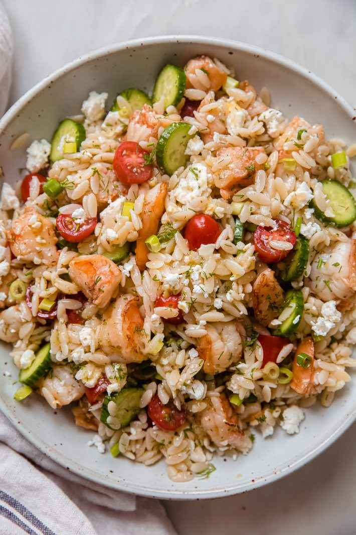 shrimp orzo salad in speckled plate