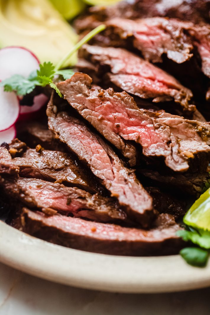 thinly sliced grilled meat on plate