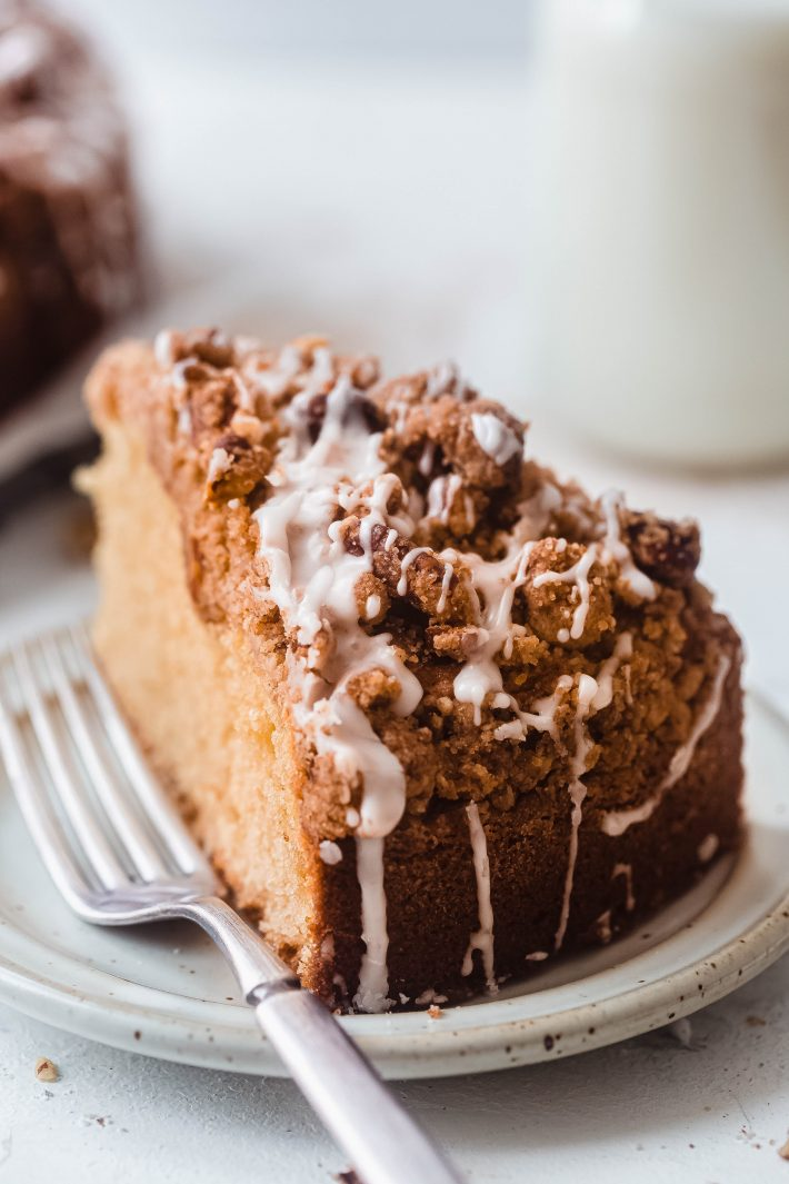 sliced coffee cake with icing on plate with fork