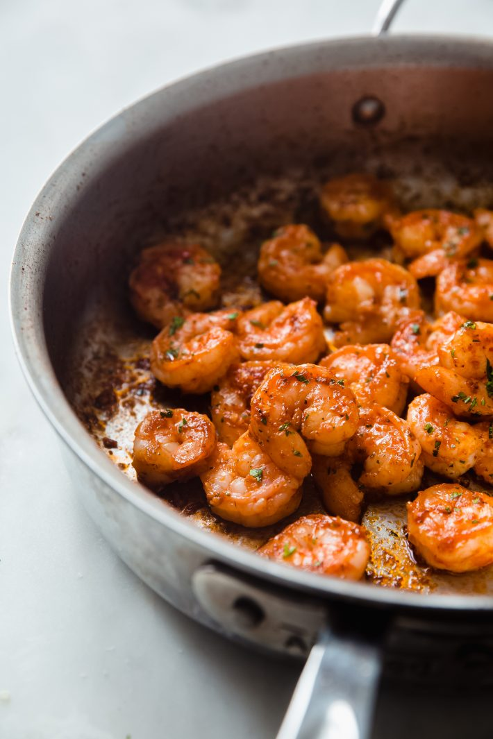 skillet with cooked chili butter shrimp