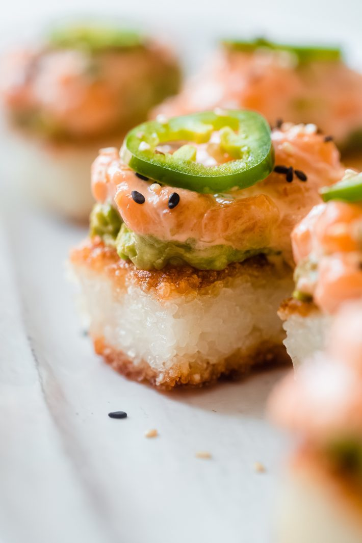 stacked crispy rice spicy salmon with jalapeno on top