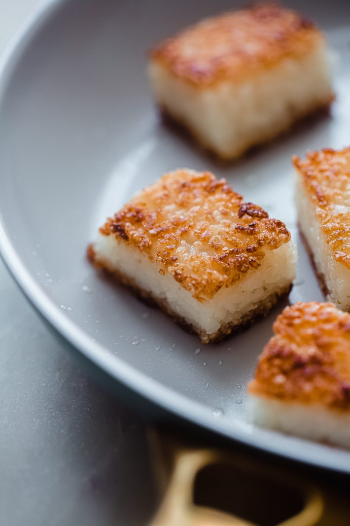 fried crispy rice cakes in skillet