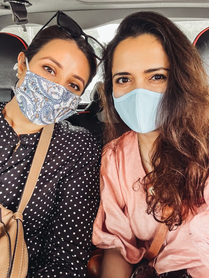 us with masks in an uber